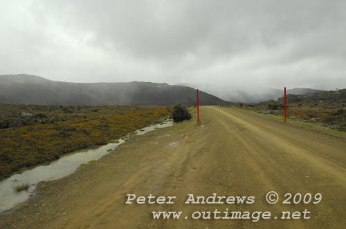 The road to Lake Dobson with snow falling over the Mawson Plateau in the background. Photo copyright Peter Andrews.