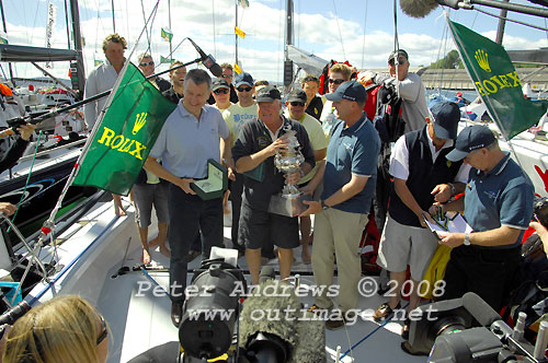 Bob Steel and crew onboard his TP59 Quest, receiving the Tattersalls Trophy for their overall win in the Rolex Sydney Hobart Yacht Race 2008. Photo copyright Peter Andrews.