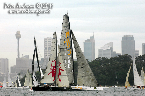 Michael Hiatt's Farr 55 Living Doll and Peter Millard and John Honan's IRC Maxi Lahana, running the length of the starting line on Sydney Harbour with the fleet, ahead of the start of the 2011 Rolex Sydney Hobart Yacht Race. Photo copyright Peter Andrews, Outimage Australia.