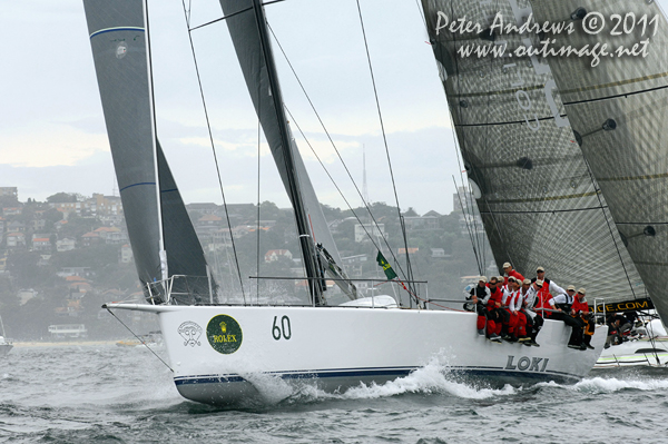Stephen Ainsworth's Reichel Pugh 63 Loki, on Sydney Harbour after the start of the 2011 Rolex Sydney Hobart Yacht Race. Photo copyright Peter Andrews, Outimage Australia.