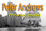 The icon banner to access the homepage of Peter Andrews. The photographic image within the icon shows a large sailing ship with square sails set, cruising up the Hudson River in New York and over the image in text is 'Peter Andrews, Photojournalist'. The buildings of the lower Manhatten skyline dominate the background, most noteably, the twin towers of New York's World Trade Centre. The sailing ship is the Norwegian sail training ship 'Christian Radich' and the photograph was taken by Peter from the stern of British registered sailing ship, 'The Eye of the Wind' during the Operation Sail 92 on New York Harbour, July 4, 1992. Click onto this icon to acces the homepage of Peter Andrews containing further links to his work, including pages of tall ship sailing and other topics.