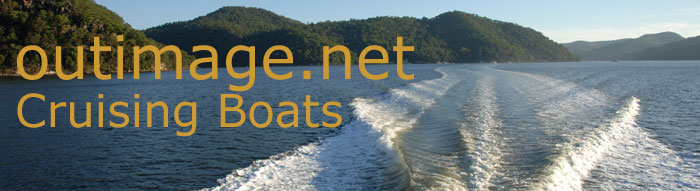 Outimage dot net cruising boats banner consists of a photo of the Hawkesbury River, dominated by the wake of the boat from where the photo was taken, extending to the horizon.
