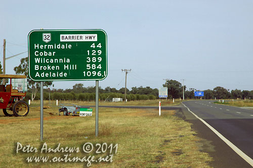 Distances from Nyngan, NSW Australia with a bit of humour thrown in. The extra 100 metres to Adelaide is not going to make much of a difference to the the long drive ahead, as seen in the following photographs. Photo copyright Peter Andrews, Outimage Australia.