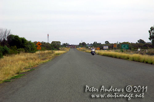 A lone biker heading out of Cobar on the Barrier Highway, NSW Australia. Photo copyright Peter Andrews, Outimage Australia.