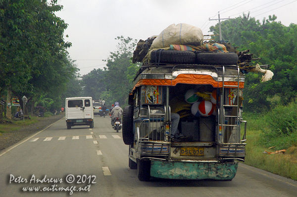 No room left in this jeepney on the highway to Kidapawan City, Davao del Sur Province, Mindanao, Philippines. Photo copyright Peter Andrews, Outimage Australia.