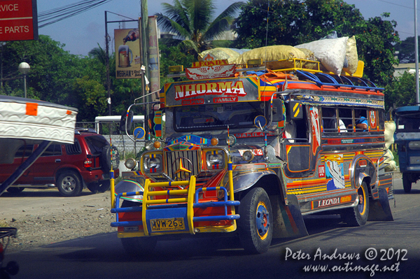 A colourful jeepney on the highway to Kidapawan City, Cotabato Province, Mindanao, Philippines. Photo copyright Peter Andrews, Outimage Australia.