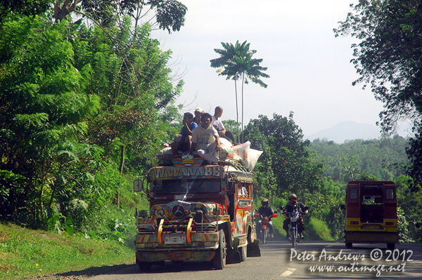 A double-decker jeepney beyond Kidapawan City, Cotabato Province, Mindanao, Philippines. Photo copyright Peter Andrews, Outimage Australia.