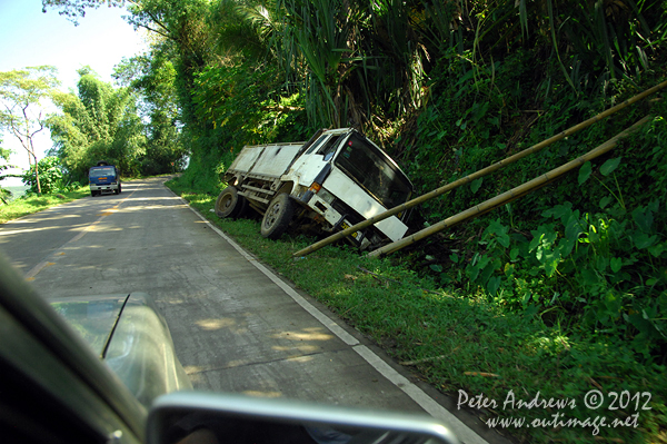 Another trucking disaster climbing a mountain pass on the President Roxas - Arakan Valley Road, Cotabato Province, Mindanao, Philippines. Photo copyright Peter Andrews, Outimage Australia.