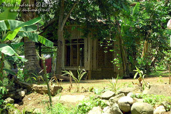 A house near Barangay, Cotabato Province, Mindanao, Philippines. Photo copyright Peter Andrews, Outimage Australia.