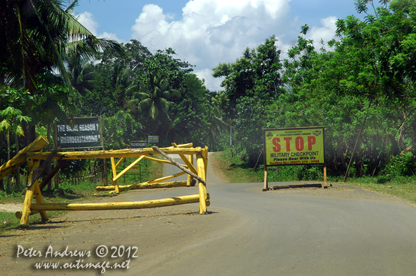 A military checkpoint along the Paco Roxas - Arakan Road, Cotabato Province, Mindanao, Philippines. Photo copyright Peter Andrews, Outimage Australia.