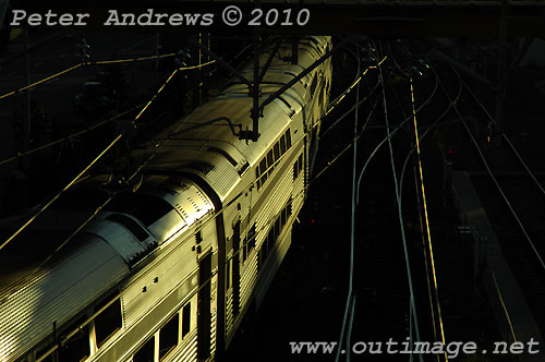 Evening train to Sydney leaving Newcastle. Photo copyright Peter Andrews, Outimage Publications.