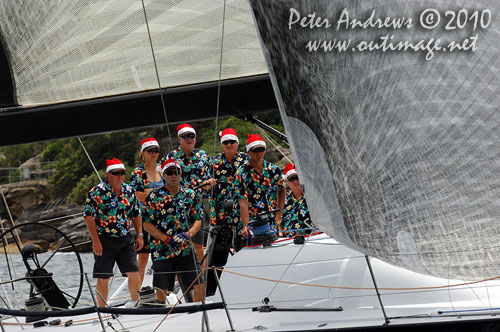 A boat-load of Santas' onboard Bob Steel's TP52 Quest, during the SOLAS Big Boat Challenge 2010 on Sydney Harbour. Photo copyright Peter Andrews, Outimage Australia.