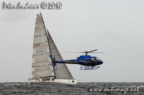 Alan Brierty's Reichel Pugh 62 Limit, behind a low flying media helicoptor, during the 2010 Rolex Trophy Rating Series offshore Sydney Australia. Photo copyright Peter Andrews, Outimage Australia.