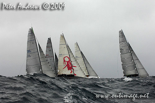 The fleet working up to the top mark during the Rolex Trophy Ratings Series 2009. Photo copyright Peter Andrews, Outimage Australia.