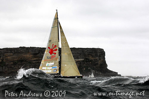 Ludde Ingvall's 90 foot maxi YuuZoo, at the heads and heading offshore after the start of the Rolex Sydney Hobart 2009. Photo copyright Peter Andrews, Outimage Australia.