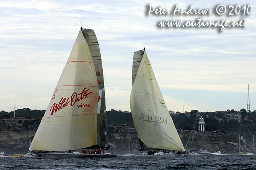 Wild Oats XI and Investec Loyal offshore with South Head in the background making way to the seaward mark for the final turn towards Hobart, after the start of the Rolex Sydney Hobart 2010. Photo copyright Peter Andrews, Outimage Australia.