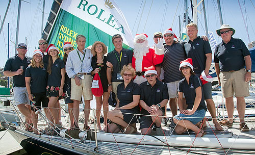 Santa visiting Bill and William Hubbard's Baltic 46 Dawn Star at the docks of the Cruising Yacht Club of Australia. Photo copyright Daniel Forster, Rolex.