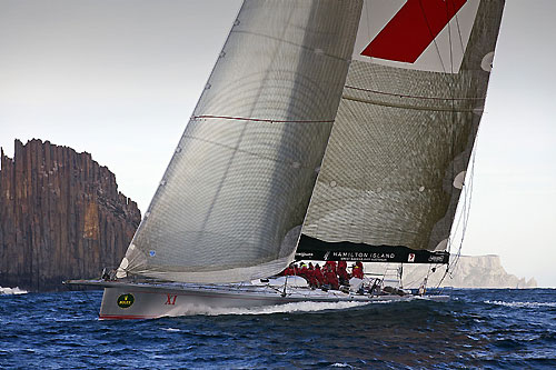 Line Honours Winner Wild Oats XI at the Organ Pipes, off Cape Raoul with Tasman Island in the background, during the Rolex Sydney Hobart Yacht Race 2010. Photo copyright Rolex and Daniel Forster.