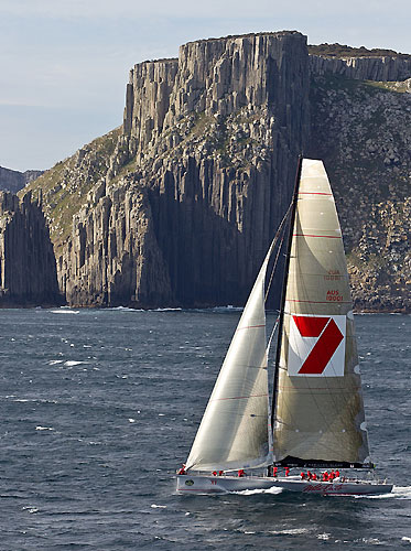 Wild Oats XI skippered by Mark Richards, rounds Tasman Island, during the Rolex Sydney Hobart 2010. Photo copyright Rolex and Carlo Borlenghi.