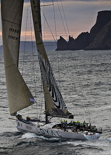 Sean Langman's 100-foot Elliott Investec Loyal, approaching Tasman Island during the Rolex Sydney Hobart 2010. Photo copyright Rolex and Carlo Borlenghi.