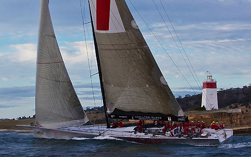 Wild Oats XI skippered by Mark Richards, at the Iron Pot lighthouse which marks the entrance of the Derwent River, during the Rolex Sydney Hobart 2010. Photo copyright Rolex and Carlo Borlenghi.