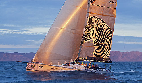 Sean Langman's 100-foot Elliott Investec Loyal, catches the sunset off Tasman Island during the Rolex Sydney Hobart 2010. Photo copyright Rolex and Daniel Forster.
