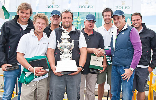The crew of Secret Mens' Business 3.5, overall handicap winners, at a dockside presentation in Hobart for division winners. Seen here with Patrick Boutellier of Rolex Australia and the Tattersalls Cup. Photo copyright Rolex and Daniel Forster.