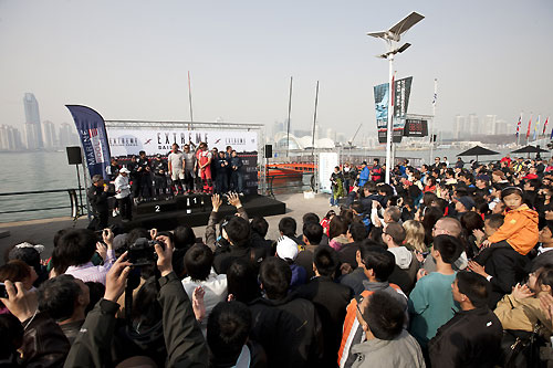 Crowds of fans and media watch the final prize giving, during the Extreme Sailing Series 2011, Qingdao, China. Photo copyright Lloyd Images.