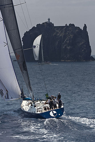 Ernesto Gismondi's Wally 65 Edimetra VI (ITA) approaches Strombolicchio, during the Rolex Capri Sailing Week and Rolex Volcano Race, Capri, Italy. Photo copyright Rolex and Carlo Borlenghi.