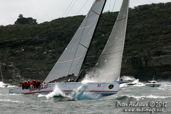Bob Oatley's Wild Oats XI at the heads of Sydney Harbour after the start of the 2012 Sydney Hobart Yacht Race. Photo copyright Peter Andrews, Outimage Australia.