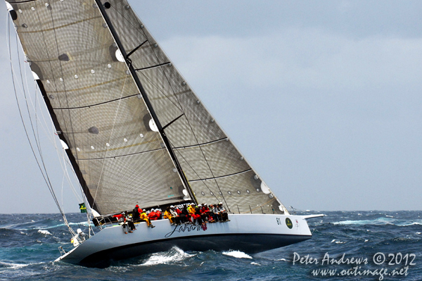 Peter Millard and John Honan's Bakewell-White 30m Maxi Lahana, outside the heads of Sydney Harbour after the start of the 2012 Sydney Hobart Yacht Race. Photo copyright Peter Andrews, Outimage Australia.