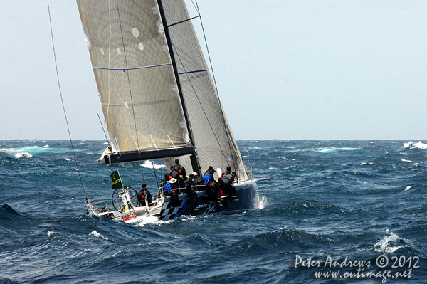 Peter Hardburg's Reichel Pugh 66 Black Jack outside the heads of Sydney Harbour after the start of the 2012 Sydney Hobart Yacht Race. Photo copyright Peter Andrews, Outimage Australia.
