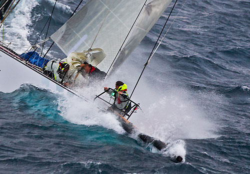 The bowman at work on Sean Langman and Anthony Bell's Elliott Maxi Investec Loyal, out in the Tasman Sea during Rolex Sydney Hobart Yacht Race 2010, Australia. Photo copyright Carlo Borlenghi, Rolex.