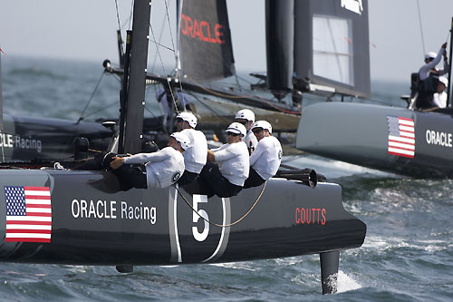 Russell Coutts' and James Spithill's ORACLE Racing AC45 wing-sailed catamarans at the America's Cup World Series, Cascais, Portugal, August 6-14, 2011. Photo copyright Morris Adant.